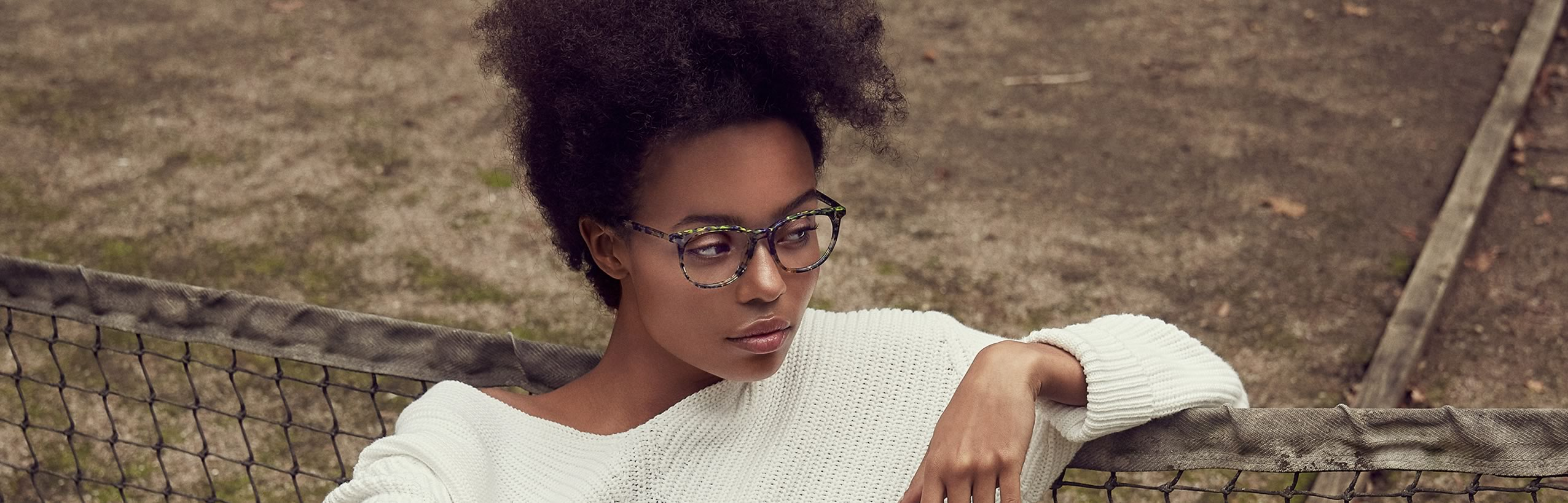 Woman sitting wearing prescription Bellinger eyeglasses