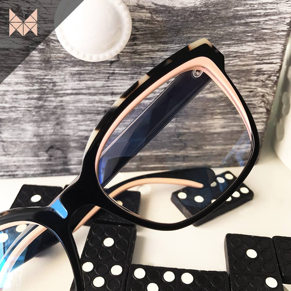 Ladies inlaid eyeglasses with dominoes in background